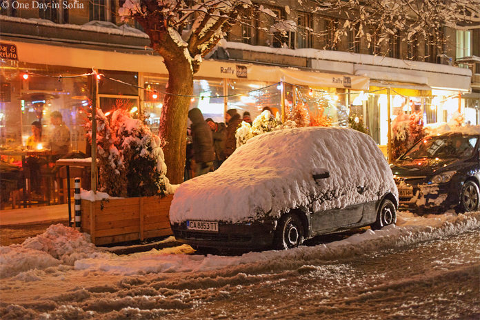 cafe and car covered in snow in Sofia