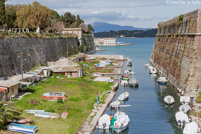 Canal with boats at Old Fortress of Corfu