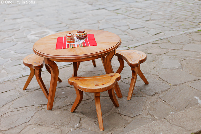 table with three-legged chairs