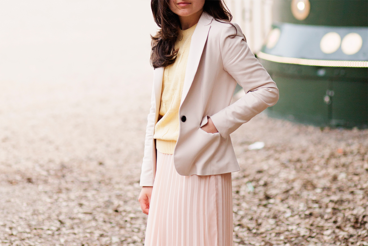 pink pleated skirt and beige blazer