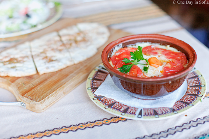 cheese dish cooked in clay pot